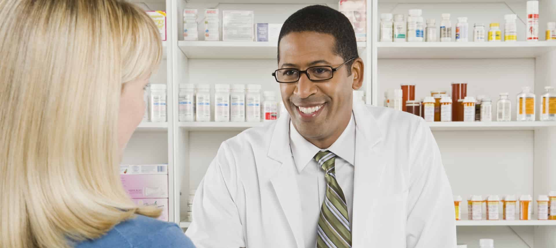 Banner Image of A Male Genesis Health Care Pharmacist Attending to a Female Patient For On-site Pharmacy
